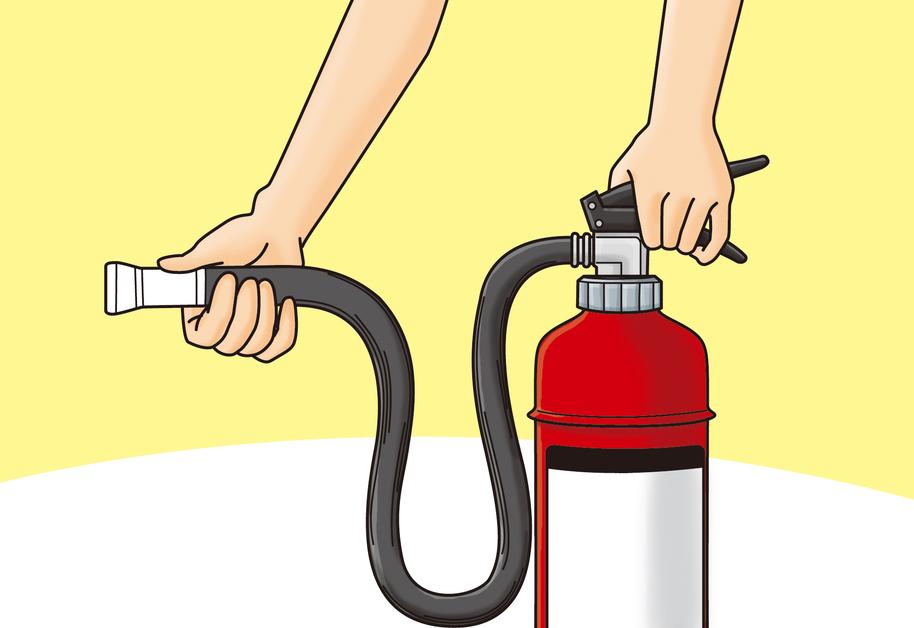 火元からある程度離れ、片方の手で消火器の底を持ち、ノズルを火元に向けます。